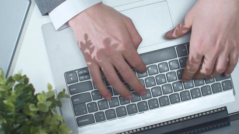 A man uses a laptop and touchpad. Top view ライブ動画