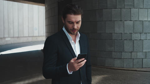 Businessman using smartphone outside. Worker browsing internet online on street Live Action