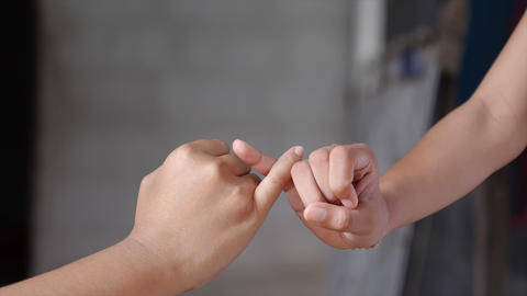Hand of girl and young woman be hand in hand metaphor contact commitment and promise 003 Live Action