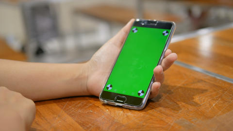 Hands of woman using mobile phone smartphone with green screen Live Action