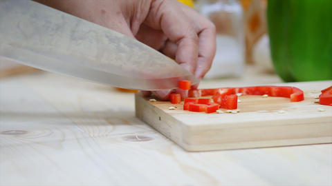 Close up shot Hands of woman using kitchen knife slice and cut the bell pepper vegetable preparing GIF