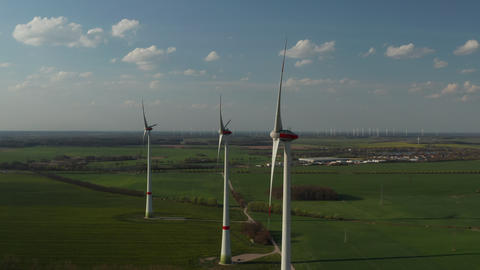AERIAL: View of Windmills Farm for Energy Production on beautiful Blue Sky Day Live Action