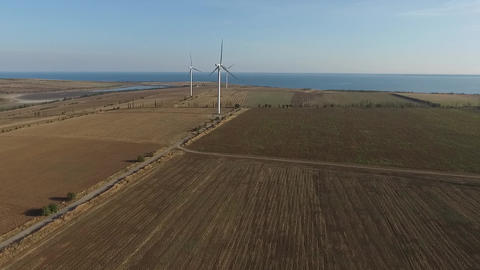 Rotating turbines of a wind farm. Renewable energy. Aerial Live Action