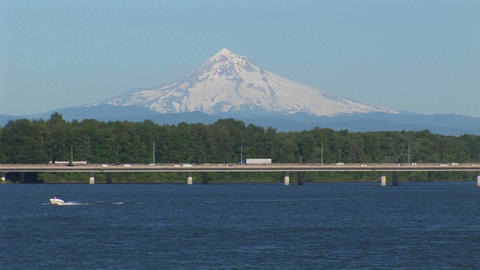 Traffic travels on a low bridge over a body of water Stock Video Footage