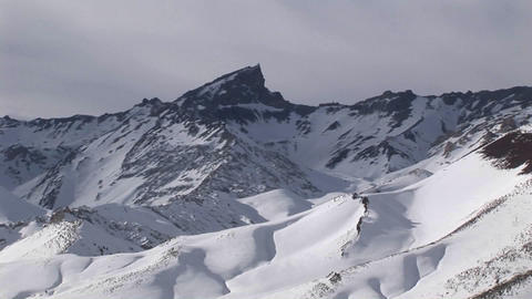 A snow covered peak on a bright afternoon Stock Video Footage