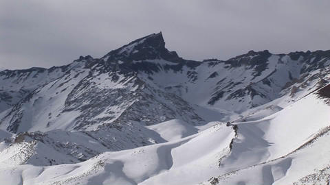 A snow covered peak on a bright afternoon Footage