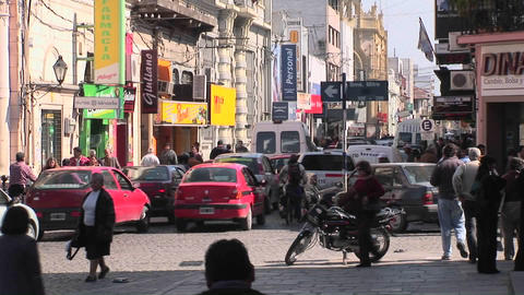 Traffic is jammed on a busy intersection as pedestrians... Stock Video Footage