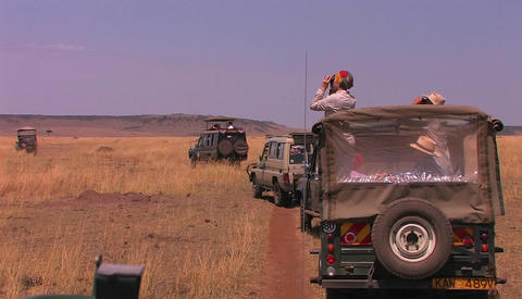 Four off road vehicles on a safari in the desert Stock Video Footage