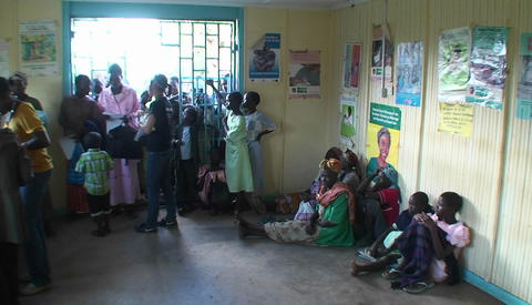 People In A Clinic Wait For Aid stock footage