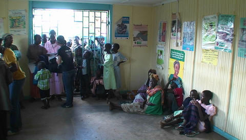 People in a clinic wait for aid Stock Video Footage