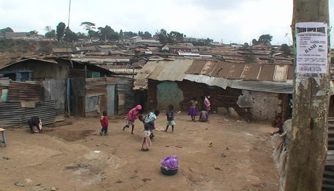 A group of children play games in front of makeshift homes in a small village Footage