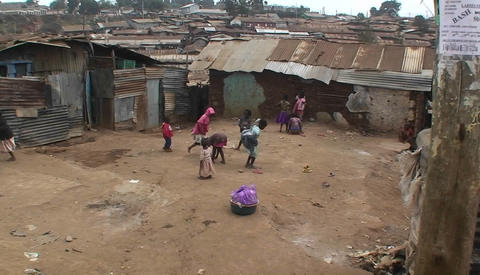 A group of children play games in front of makeshift... Stock Video Footage