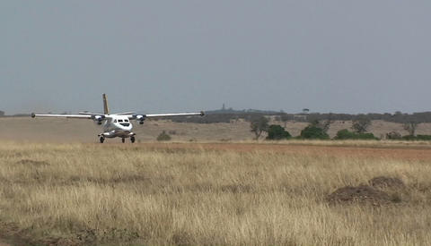 A small plane takes off from a rural dirt road airstrip Stock Video Footage