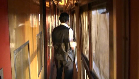 An attendant on a train walks up and down the aisle... Stock Video Footage