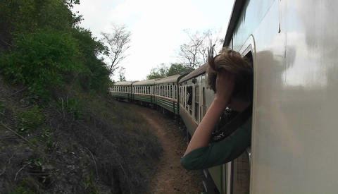 A woman sticks her head out the window letting her hair... Stock Video Footage