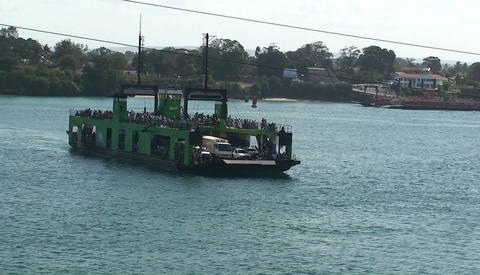 A ferry boat carries people and vehicles across a body of water Live Action