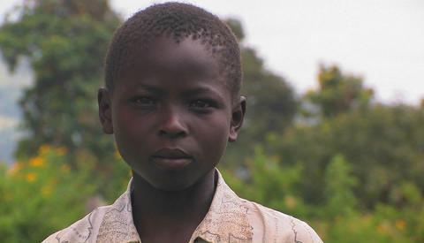 A young African boy with a serious expression on his face Footage