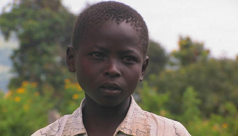 A young African boy with a serious expression on his face Stock Video Footage