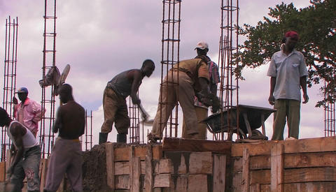 Workers in a construction site in Africa Stock Video Footage