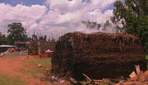 Men are constructing a building, and steam is coming off... Stock Video Footage