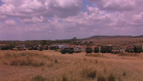 Off road vehicles near a river in African savanna Stock Video Footage