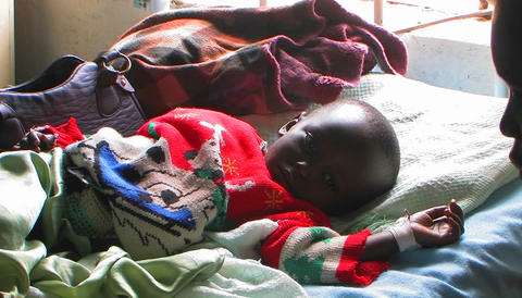 An African baby lying in bed in a hospital Stock Video Footage