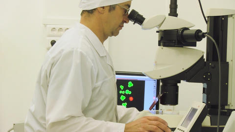 man looking in microscope Stock Video Footage