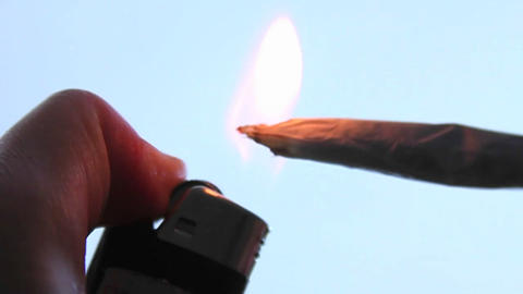 A person lights a joint Stock Video Footage