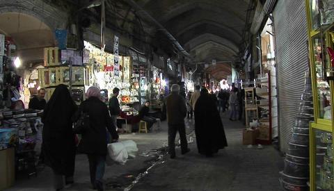 A shoppers pass through a bazaar in Iran Stock Video Footage