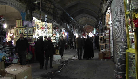 A shoppers pass through a bazaar in Iran Stock Video Footage