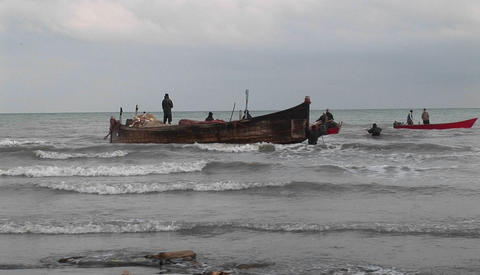 Fishermen on a traditional style boat and motorboats off the coast of Iran Footage
