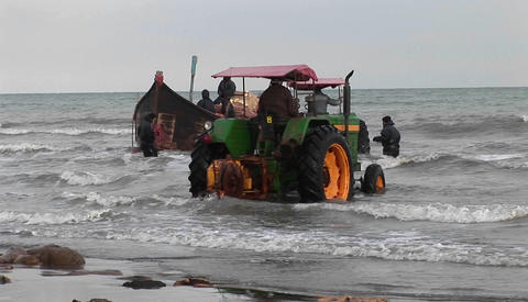 Several tractors roll into the water off the coast of Iran Footage