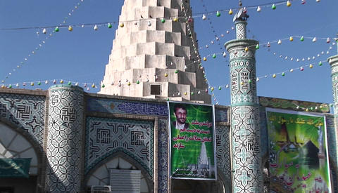 An election poster featuring Mahmoud Ahmadinejad on a wall outside the Tomb of the Prophet Daniel in Footage
