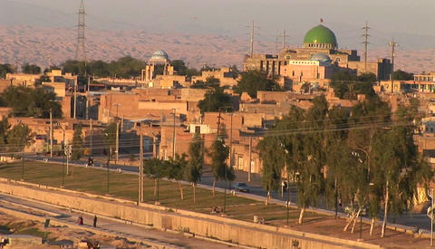 A city in Iran featuring a building with a green dome Footage