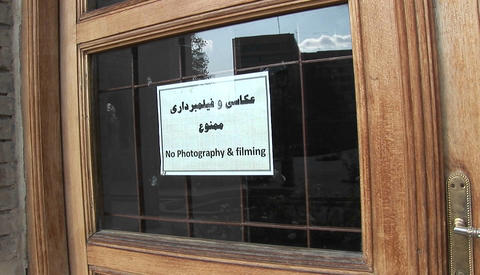 A sign on a window in Iran warns visitors that... Stock Video Footage