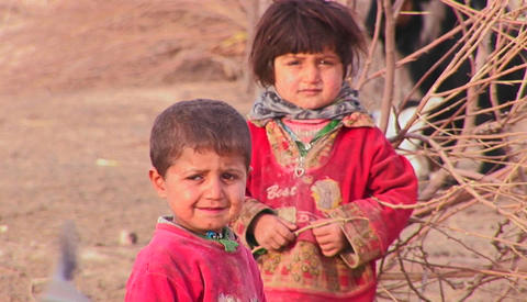 Two Iranian children in a rural location Footage