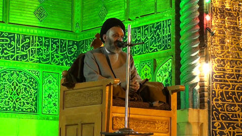 A religious leader speaks to followers in a mosque Stock Video Footage