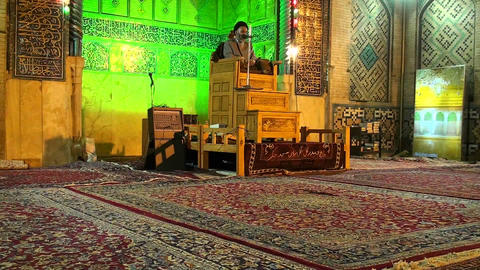 A religious leader speaks to followers in a mosque Footage