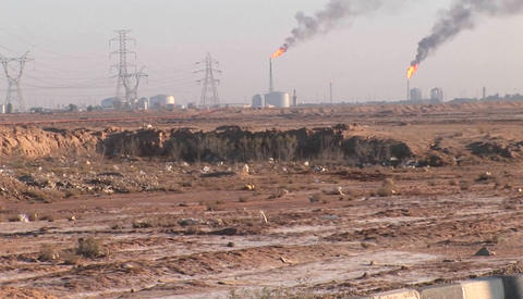 Burning extraction wells in an oil or natural gas field in Iran Footage