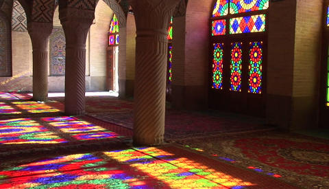 Sun shines through stained glass windows inside the Nasir Molk Mosque in Shriaz, Iran Footage