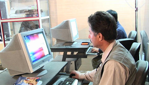 A man works on a computer in an office in Iran Stock Video Footage
