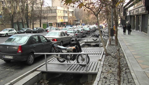 A motorbike on a city street in Iran Stock Video Footage