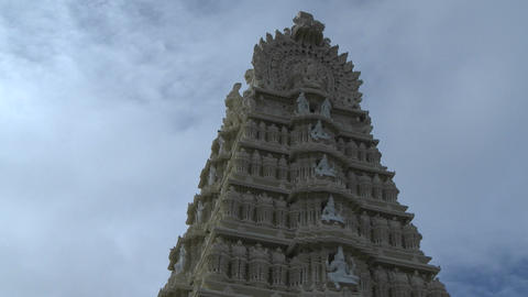 Time lapse of clouds above an ancient temple tower Stock Video Footage