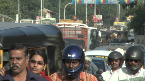 A street in India is crammed with vehicles and people Footage