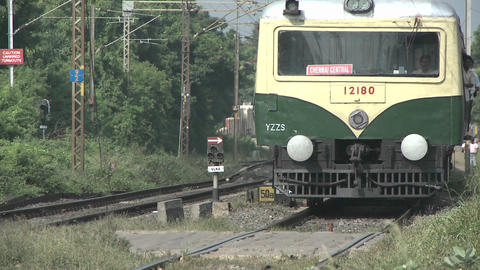 A passenger train approaches quickly Stock Video Footage
