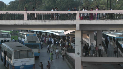 People gather in a bus station, getting on and off buses... Stock Video Footage