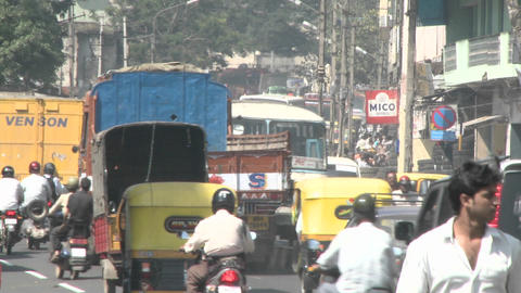 Traffic flows on a busy street in an Indian city Stock Video Footage