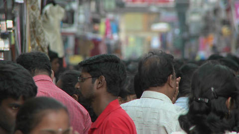 People walk on a crowded street in India Stock Video Footage