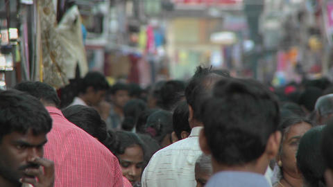 People walk on a crowded street in India Footage