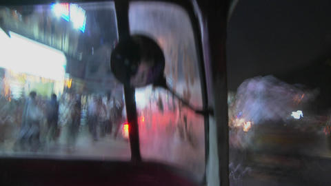 A blurred view from a motorized rickshaw driving down a... Stock Video Footage